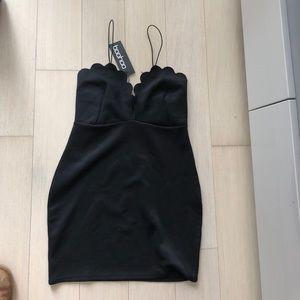 Brand new black mini dress